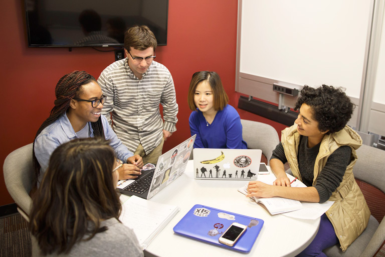Five students work on a group project.