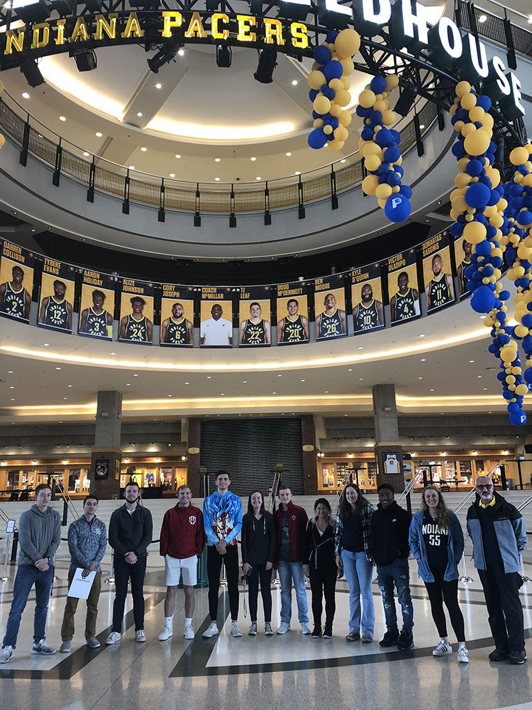 Students pose in Bankers Life Fieldhouse.