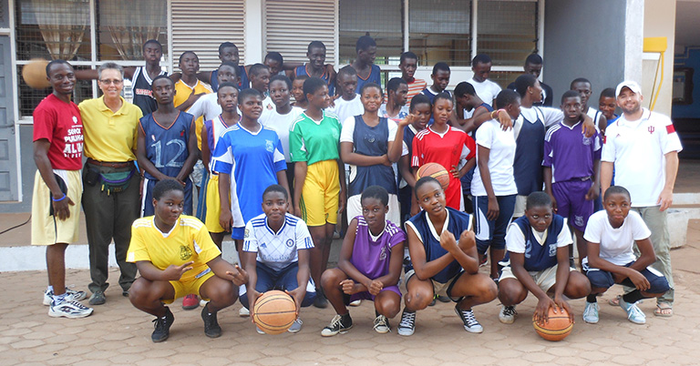 A group of students with basketballs.